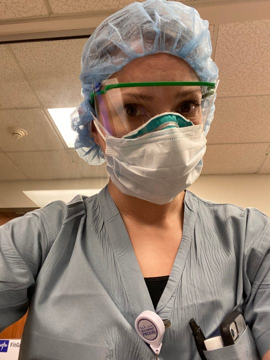 A selfie of Maureen Biddinger-Grisius, a registered nurse at Beaumont Hospital, Farmington Hills, in her protective gear for helping COVID-19 patients.