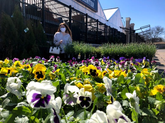 Various flats of flowers for sale outside of the Lowe's garden center on Metro Parkway in Sterling Heights, Michigan, on April 2, 2020.