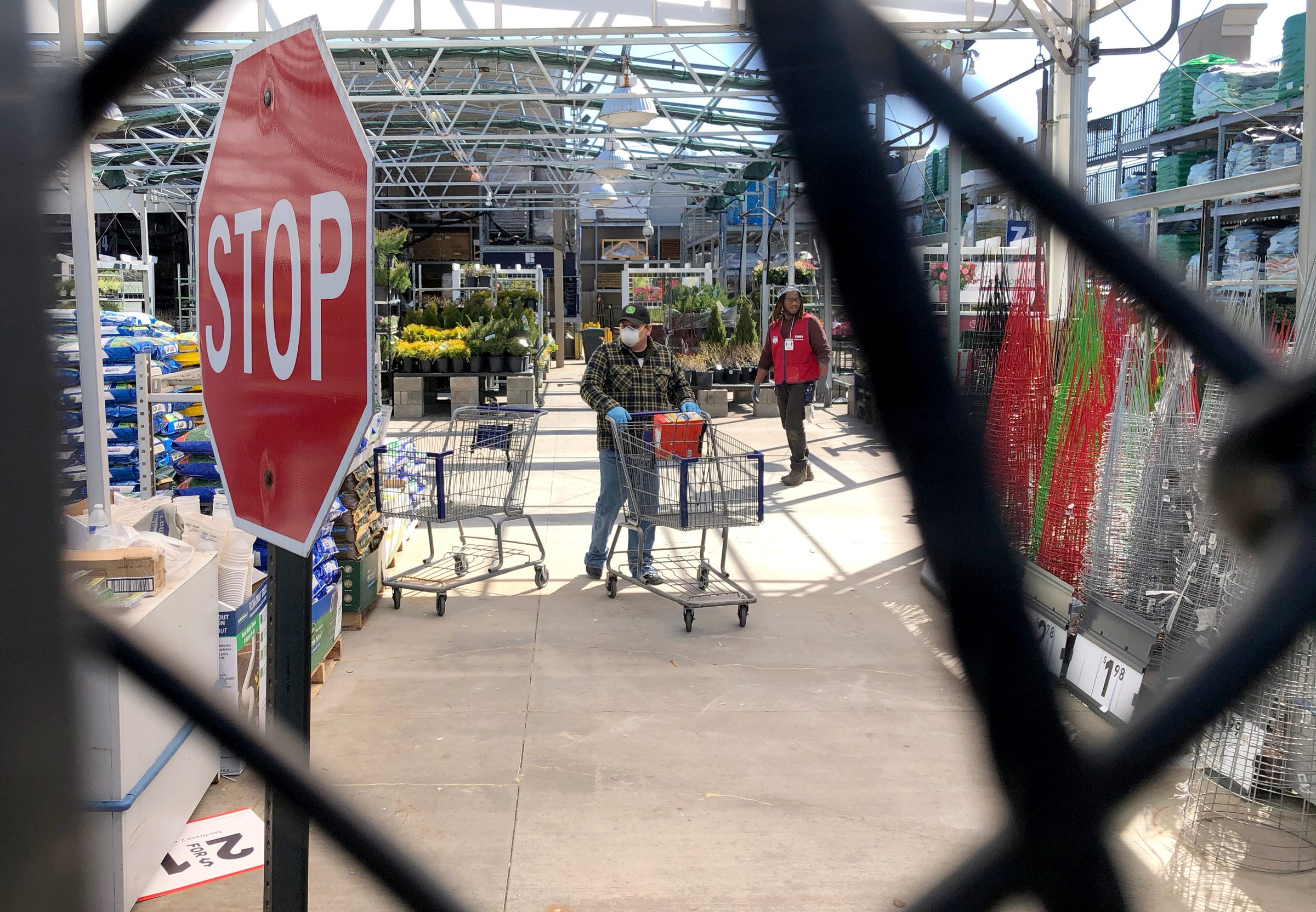 At this Lowe's on Metro Parkway in Sterling Heights, Michigan, on April 2, 2020, the outside entrance of the garden center was closed to shoppers but shoppers could enter through the inside of the store.
