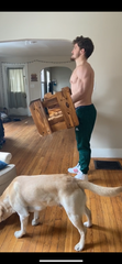 Eastern Michigan wide receiver Mathew Sexton works out in his living room to stay ready for the NFL draft.