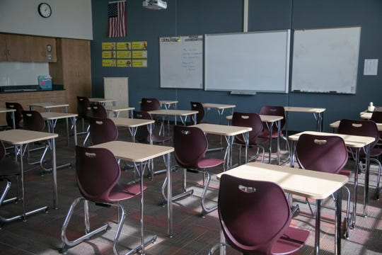 Desks sit empty March 13 at U of D Jesuit High School in Detroit as schools were ordered shut while the coronavirus threat looms.