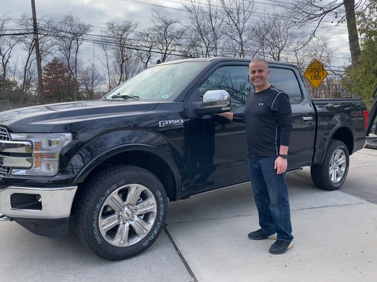 """Mohamad """"Catfish"""" Baidoun is a longtime Ford car salesman whose dealership is closed due to the novel coronavirus. He is pictured here with his 2020 Ford F-150 in his front yard on Wednesday in Dearborn Heights."""