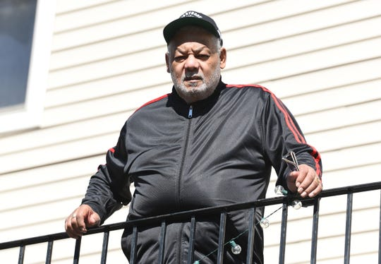 A fearful and vulnerable Richard Welch, 71, of Detroit stands on his balcony patio avoiding contact because he is afraid of contracting the coronavirus.