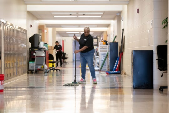 Lorna Bryant, a custodian with RNA Facilities Management, mops the floor inside Renaissance high school, which was being cleaned due to the corona virus, April 2, 2020.  Every classroom was emptied of furniture for the cleaning.