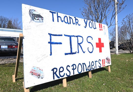 A thank you sign at Craig's Auto Electric repair shop along John R Road in Madison Heights highlights the efforts of first responders on Thursday, April 2, 2020.