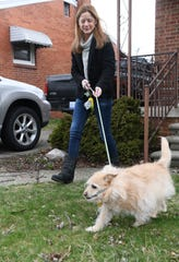 Lori Schubring, 45, walks her dog, Jack, near her home in Warren, Mich. on Apr. 2, 2020. Lori Schubring has progressive multiple sclerosis and has been staying very close to home.