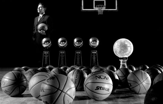 Tom Izzo with his trophy collection in 2000, a collection that has grown through the years.