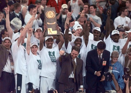 The Michigan State basketball team celebrates the national championship on April 3, 2000, in Indianapolis.