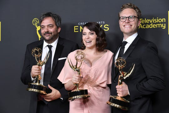 """Adam Schlesinger, from left, Rachel Bloom and Jack Dolgen hold the awards for outstanding original music and lyrics for """"Crazy Ex Girlfriend"""" on Sept 14, 2019, at the Creative Arts Emmy Awards in Los Angeles."""