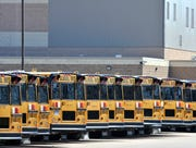 Busses are line up in the Larry F. Brender Support Services Center bus yard at L'Anse Creuse Public Schools in Clinton Twp., Thursday, April 2, 2020.  Michigan Gov. Gretchen Whitmer officially closed all K-12 buildings for the rest of the school year.