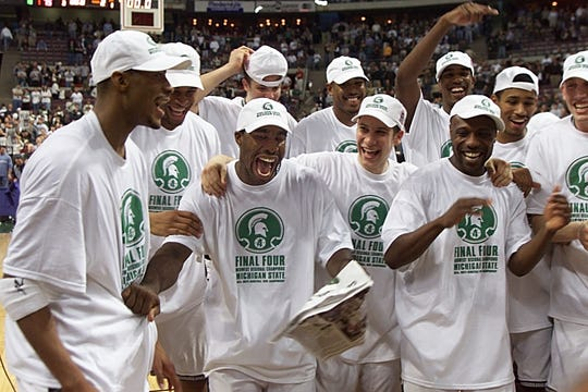 Mateen Cleaves, Morris Peterson and the Spartans celebrate the win over Iowa State that earned MSU a ticket to the Final Four.