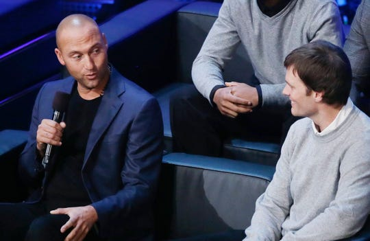 Derek Jeter together with Tom Brady at Michigan's Signing Day gala in 2016.