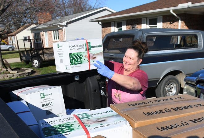 Jennifer Ruffner-Modi with a truck load of boxes of gloves she bought for first responders after he lost her uncle, Eric Dubke, to the coronavirus in March.