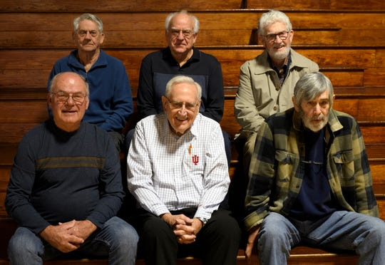 Members of the 1961 Haubstadt basketball team pose for a picture together including Coach Don Sakel, front row center, in their old High School gymnasium in Haubstadt, Ind., Saturday afternoon, March 14, 2020. They won the the only sectional title in school history by beating Fort Branch in triple overtime with a final score of 14-12.