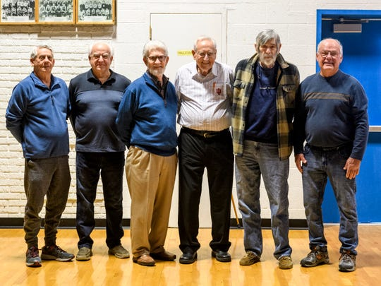 Members of the 1961 Haubstadt basketball team pose for a picture together including Coach Don Sakel, fourth from left, in their old High School gymnasium in Haubstadt, Ind., Saturday afternoon, March 14, 2020. They won the the only sectional title in school history by beating Fort Branch in triple overtime with a final score of 14-12.