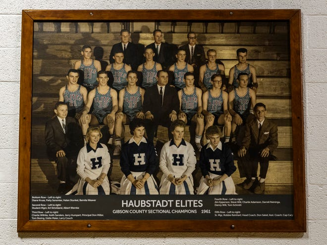 A painted portrait of the 1961 Haubstadt basketball team is displayed in the old High School gymnasium in Haubstadt, Ind. The team won the the only sectional title in school history by beating Fort Branch in triple overtime with a final score of 14-12.