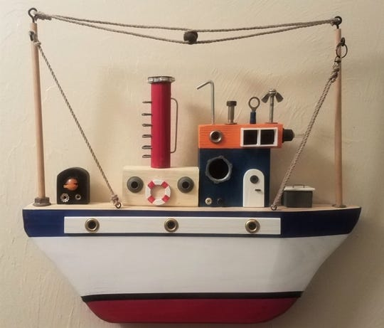 Colorful mini-boats made by Tom Higgins will be part of an exhibition that'll resume when the Cape Coral - Lee County Public Library reopens.