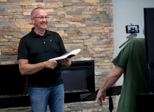 Pastor Gary Cox of First Christian Church of Fort Myers records segments of his Sunday worship service on Wednesday, April 1, 2020.