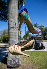 """One pair of shoes recently added to Annette Brown's line reads, """"The spring of Tiger King."""""""