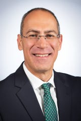 Michael Alexander has been hired to serve as the University of Wisconsin-Green Bay's seventh chancellor.