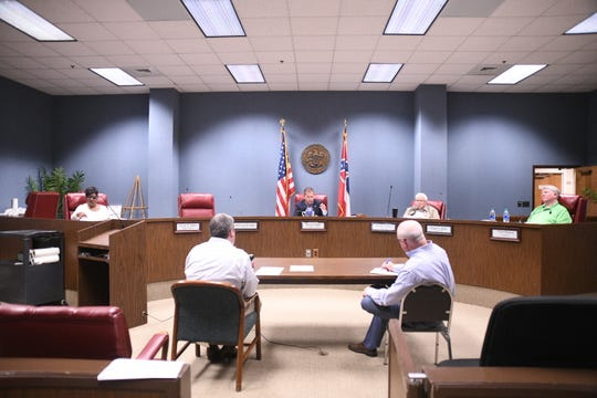 The Forrest County Board of Supervisors are spread out to meet social distancing requirements for their meetings, including this special-called meeting Thursday, April 2, 2020. The board subsequently required masks to be worn in county buildings as well.