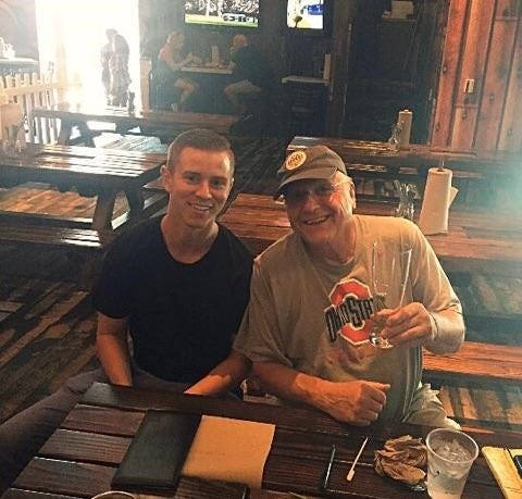 Lawrence North High School basketball assistant coach Jim DeSalle (right), died Wednesday, he shown here with Jake Stanbrough, the son of a Lawrence North assistant.