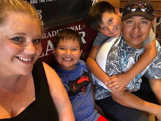 Brandi Lordeo, of Brandon, said it's stressful working from home while her two sons, Niki and EJ, do distance learning. Lordeo's husband, Joaquin, is often away on business. Pictured left to right: Brandi, Niko, EJ and Joaquin Loredo of Brandon.