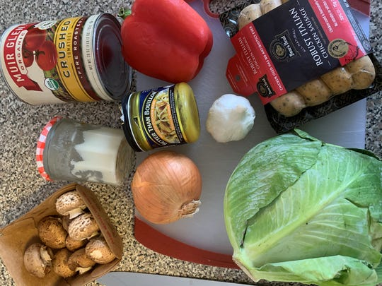 The ingredients for Chef Cassidee Dabney's tomato braised cabbage with chicken sausage and hot buttered rice. Dabney is the executive chef at The Barn at Blackberry Farm.