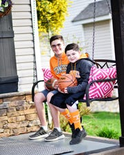 Jack and Grant Gornaflo in their favorite Tennessee gear in Halls on March 26, 2020.
