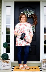 "Photographer Allison Roop on her own porch before heading out to photograph families, April 1, 2020. ""We took our golf cart around in my neighborhood to take photos,"" she said. ""It was hard to stay away (at a safe social distance); my little girl wanted to hug her friends."""