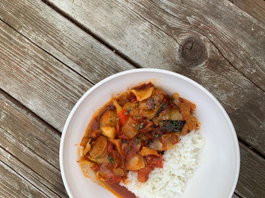 Chef Cassidee Dabney's recipe for tomato braised cabbage with chicken sausage and hot buttered rice. Dabney is the executive chef at The Barn at Blackberry Farm.