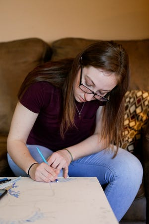 Harrison senior Kaity Harley works on an art project of a ballerina her sister dances with, Thursday, April 2, 2020 at her Lafayette home.