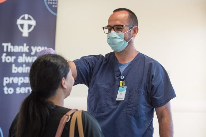 Mark Aycock screening employees. Medical staff at Our Lady of Lourdes Hospital are part of the essential workforce providing healthcare services. Wednesday, April 1, 2020.