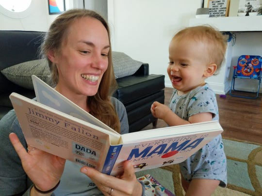 Prairie Elementary librarian Jennifer Cohen shares a photo of reading at home with 1-year-old Louie as part of an at-home spirit day via Facebook. It's one way the school is encouraging students and families to read at home while schools are closed to help stop the spread of COVID-19.