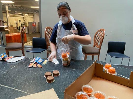 A volunteer preps snack bags at Second Harvest Food Bank.