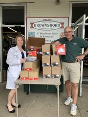 Dr. Tracy Miller of Baptist Health Louisville With Jim Lehrer of Brownsboro Hardware & Paint.
