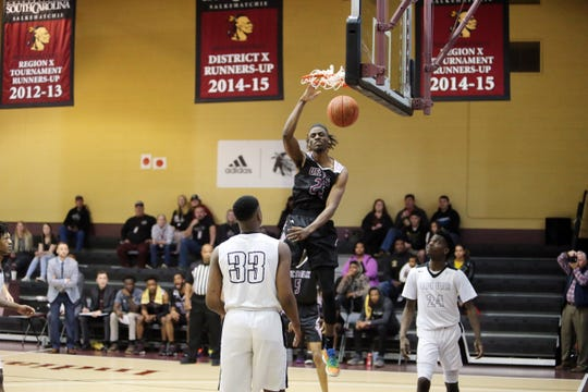 Ahmad Rand finishes off a dunk during a game last season at USC Salkehatchie. Rand verbally committed to Memphis Thursday.