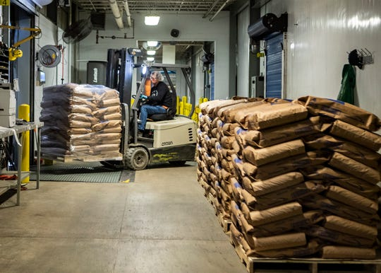 A worker at the Fleischmann's Yeast manufacturing plant moves packages of yeast in Memphis on Thursday, April 2, 2020.