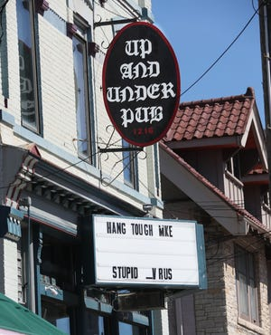 The Up And Under Pub at 1216 East Brady Street delivers a covid-19-related message to Milwaukee on its marquee on April 2, 2020.