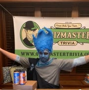 Ryan Wickens dresses in costume for his Quizmaster Trivia, a bar and restaurant game that has moved online.