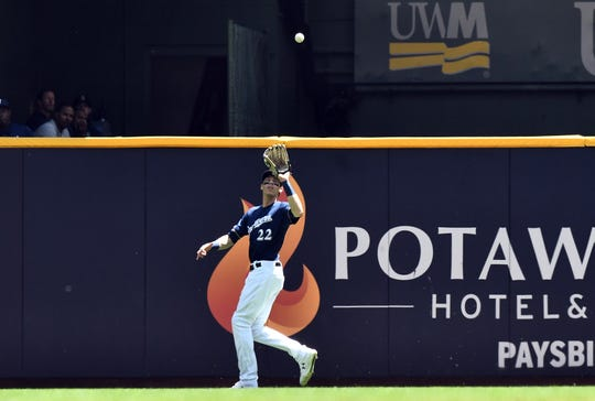 Brewers rightfielder Christian Yelich catches a fly ball against the Mariners at Miller Park on June 27, 2019. Yelich has been keeping busy recently by playing catch with his brother in the Los Angeles area.