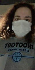 Alexis Garuz of Waukesha faces her masked self in a mirror as fights off her bout with COVID-19, the deadly virus that reached pandemic status in March. Garuz, who was not formally tested during her March 30 exam at ProHealth Waukesha Memorial Hospital, said she suspects the number of confirmed cases is well understated, based on her own experience.