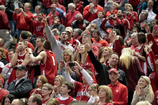 Badger fans celebrate the win during the  third round of the NCAA Men's Basketball Championship between Wisconsin and Oregon at the BMO Harris Bradley Center in Milwaukee, Wisconsin, Saturday, March 22, 2014.