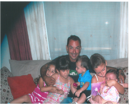 Charles Petrock Jr. with his children.
