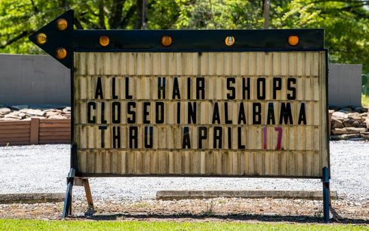 A sign outside of a barber shop in Huguley, Ala., on Thursday April 2, 2020. Hair shops are closed because of the coronavirus outbreak.