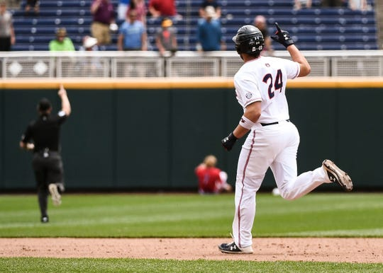 Auburn's Conor Davis (24) rounds the bases after a home run against Louisville in the College World Series on Wednesday, June 19, 2019, in Omaha, NE.