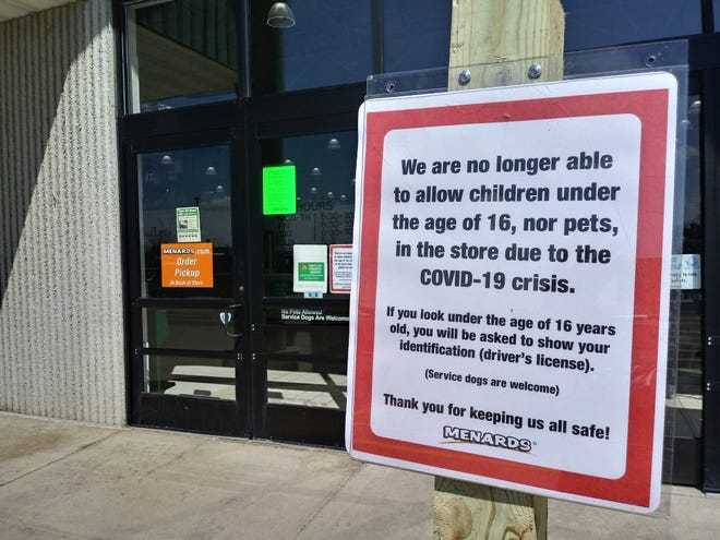 A sign relaying additional restrictions for Menards on April 2. Stores across the county have implemented different policies to promote social distancing and halt the spread of COVID-19, but officials have said it may not be enough.