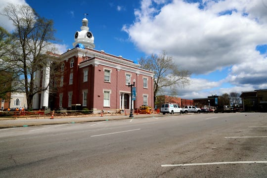 Little activity and several empty parking spots are seen midday near the Historic Rutherford County Courthouse on Wednesday, April 1, 2020, at the public square in Murfreesboro, Tenn.