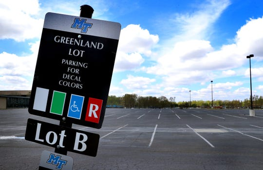 The Greenland Drive parking lot at Middle Tennessee State University was empty in early April after classes moved to a remote learning format due to the coronavirus pandemic. University officials announced a plan for on-campus learning for the fall 2020 semester on Friday.