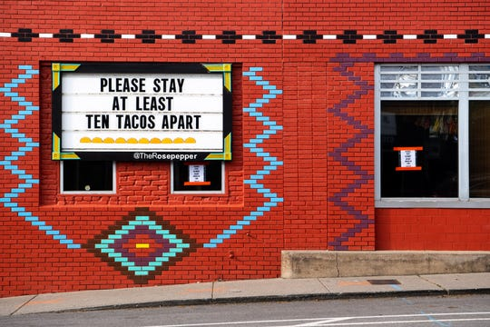 A sign at Rosepepper Cantina in Nashville, Tenn., Wednesday, April 1, 2020. The East Nashville restaurant has adapted to the times by creating an efficient method for fulfilling take-out food and margarita orders.